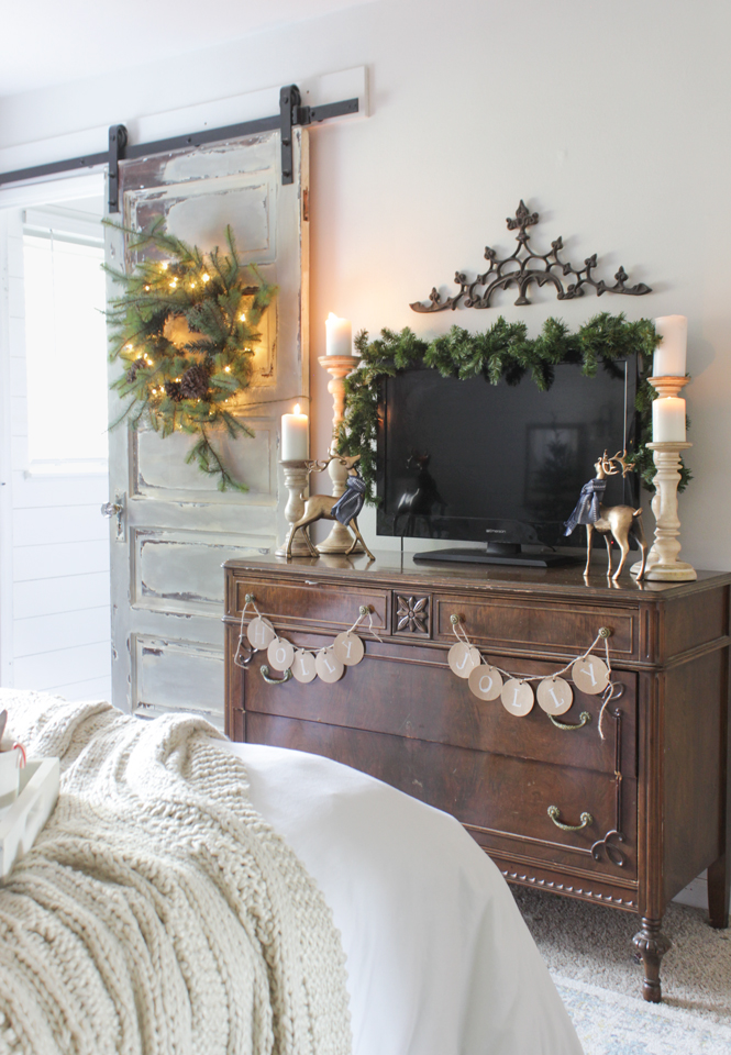Vintage dresser and barn door with rustic Christmas decor