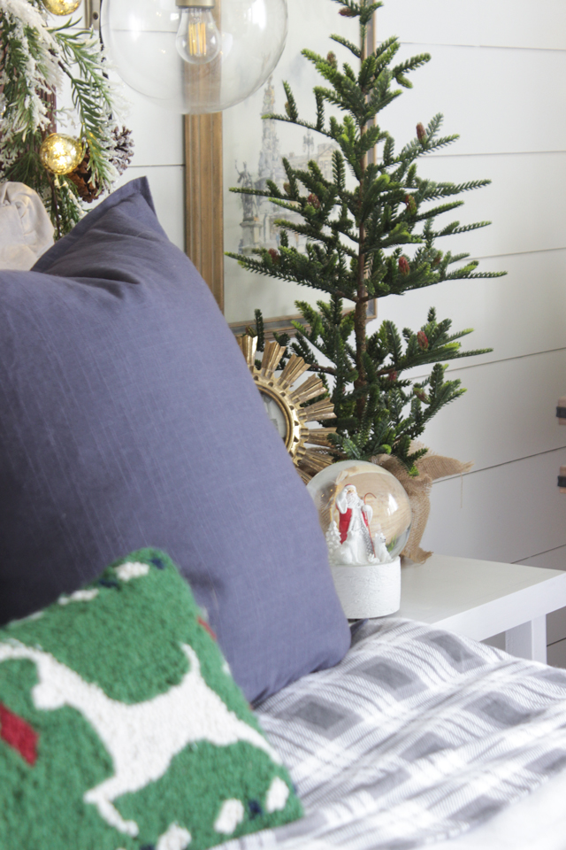 Faux tree on bedside table and a snow globe- Christmas Decor