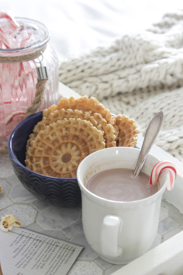 Christmas bed tray with hot cocoa, pizelles, and candy canes