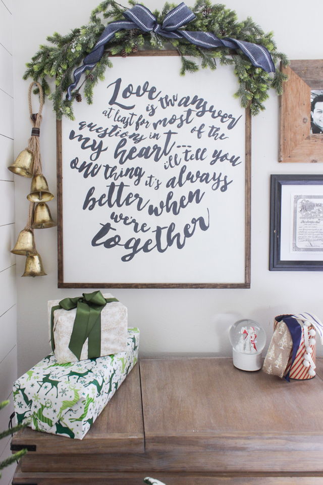 DIY word art with a garland on top and a gold bells- Christmas Decor for a Gallery Wall
