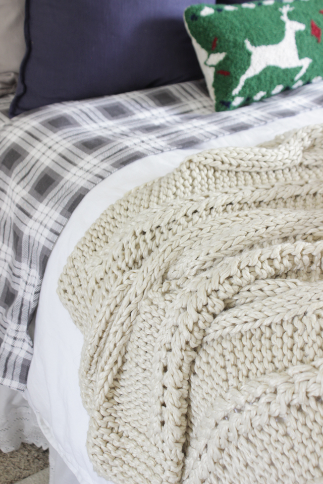 Cable knit wool throw for cozy textures on a bed