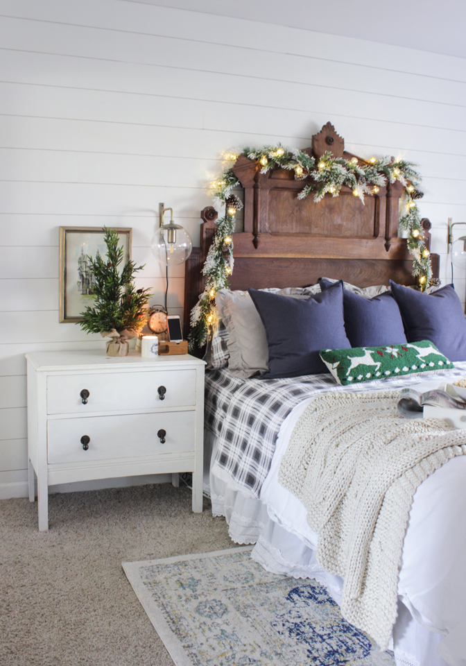 Rustic Christmas master bedroom with garlands for a cabin feel
