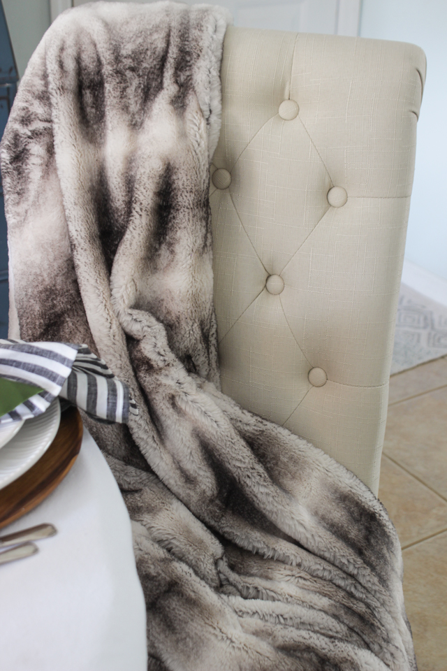 Faux fur throw on tufted dining chair - Shades of Blue Interiors