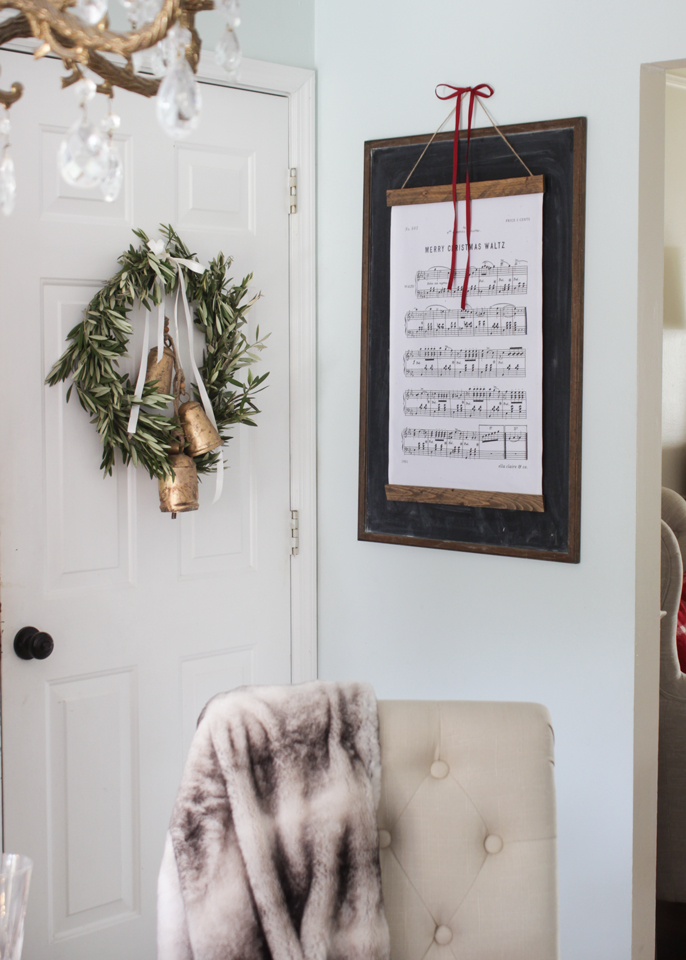 Fresh olive wreath and a Christmas Hymn wall hanging