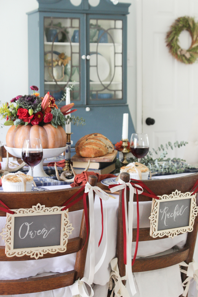 A colorful Thanksgiving Tablescape with name signs on chairs