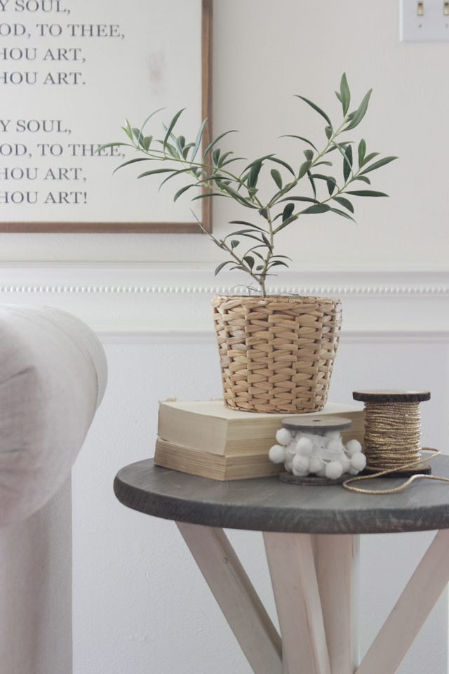 Olive plant on trestle end table