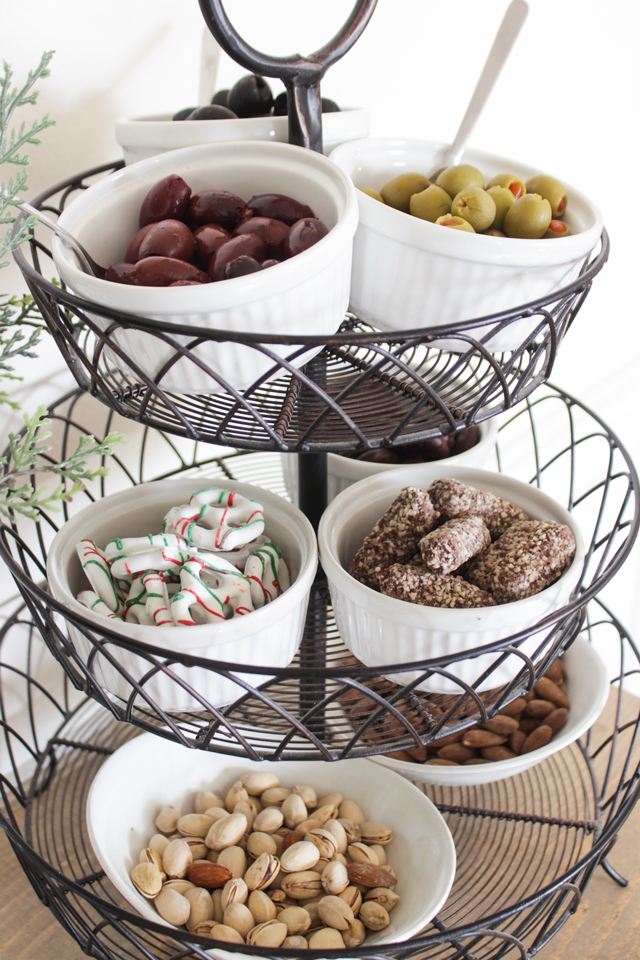 Tiered stand with bowls of snacks