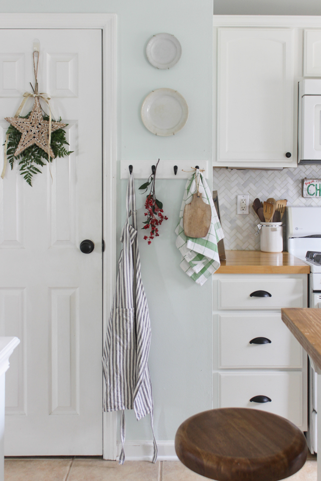 Christmas star on pantry door and kitchen hooks