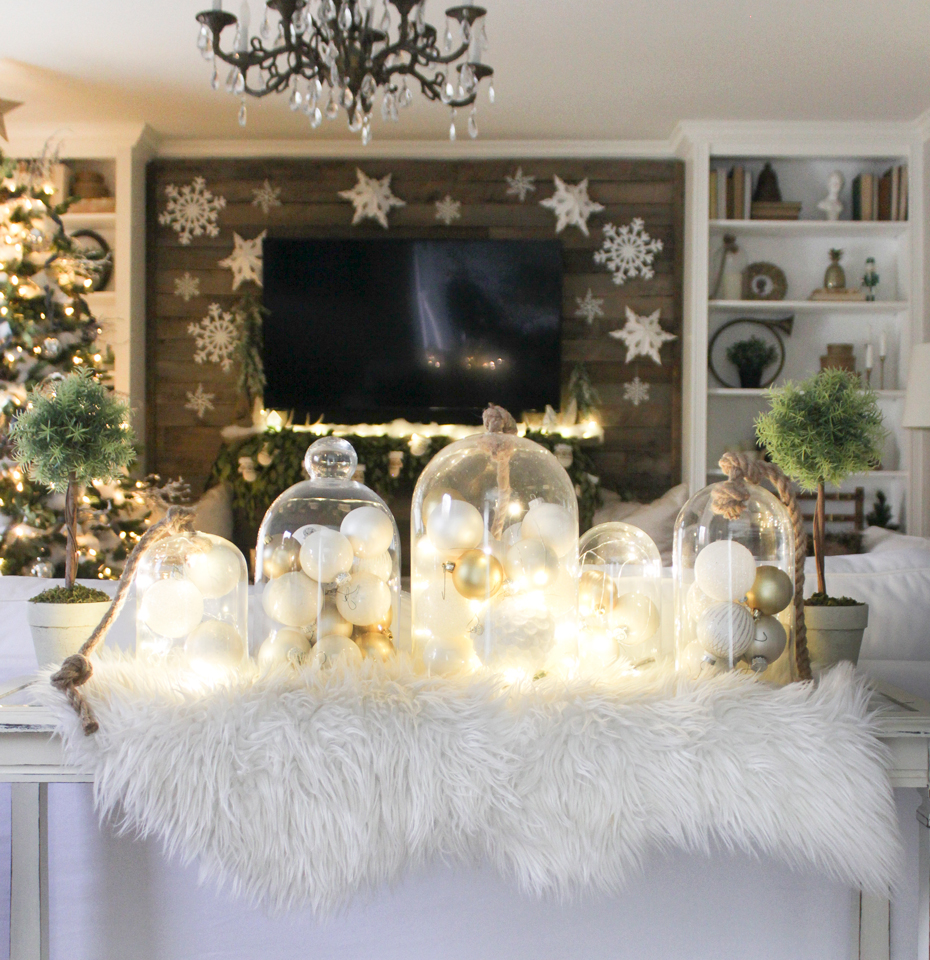 Glass cloches with lights and ornaments