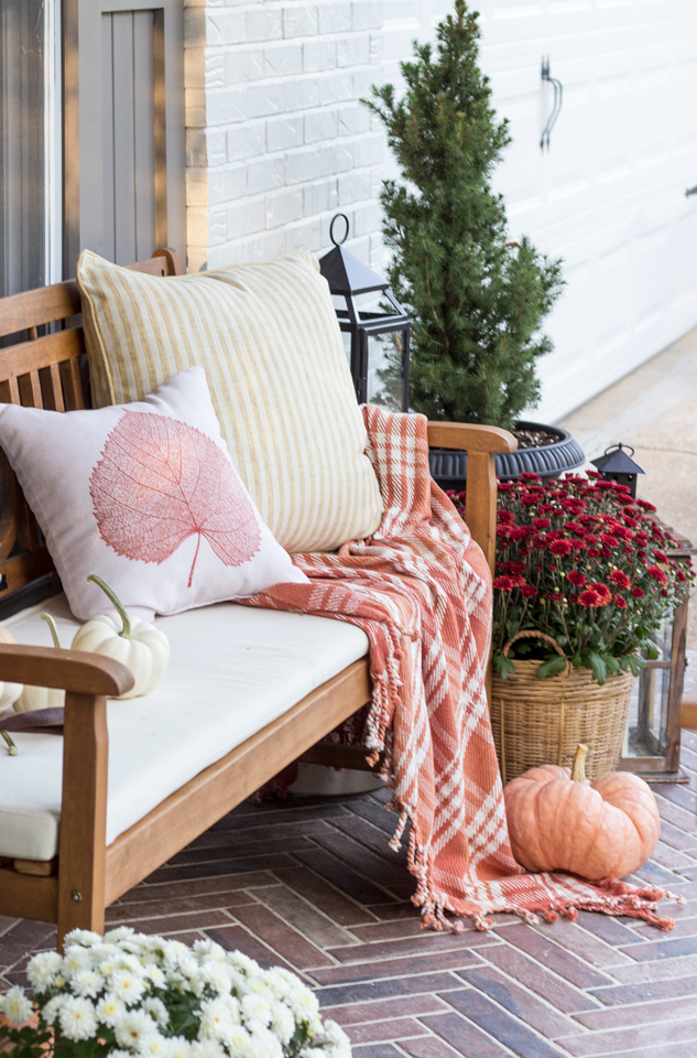 Cozy bench on a fall front porch