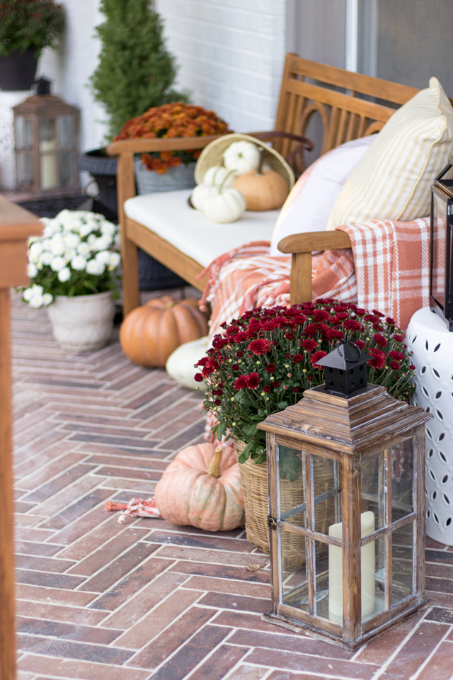 Fall front porch with herringbone brick tile