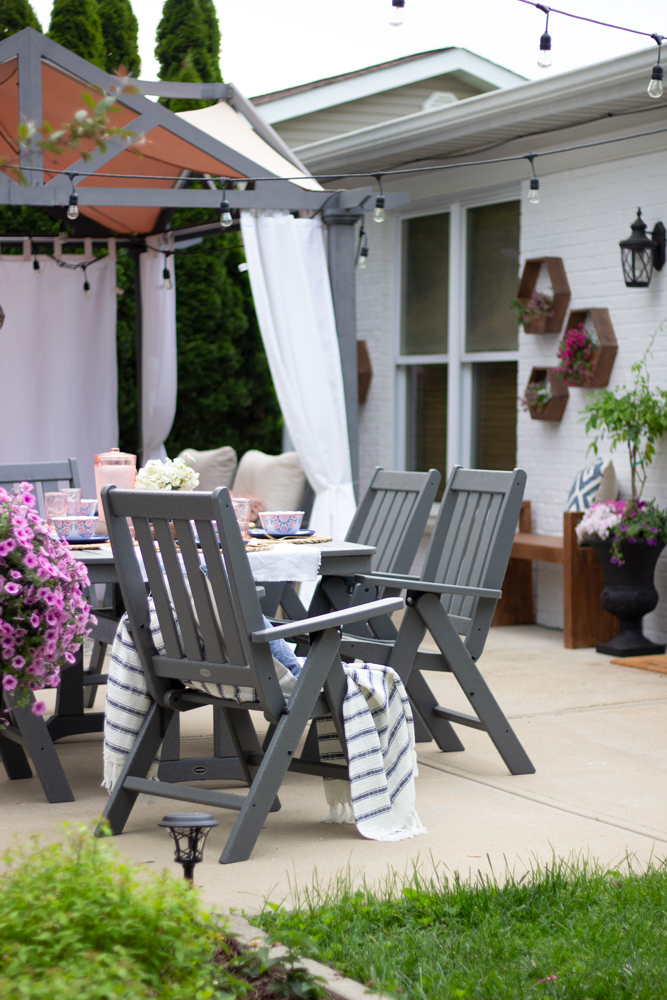 Outdoor dining with gray furniture on the patio