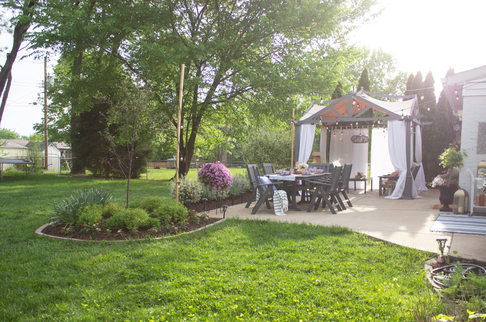Patio makeover with pergola and gray outdoor furniture